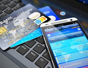 cell phone, credit cards, and computer keyboard